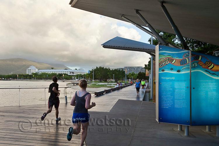Joggers on the Esplanade boardwalk.  Cairns, Queensland, Australia