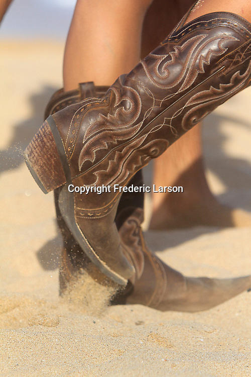 Cowboy boots at Sandy Beach in Hawaii seem to be in fashion.