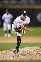 Charlotte Knights relief pitcher Ian Hamilton (17) follows through on his delivery against the Toledo Mud Hens at BB&T BallPark on June 22, 2018 in Charlotte, North Carolina. The Mud Hens defeated the Knights 4-0.  (Brian Westerholt/Four Seam Images)