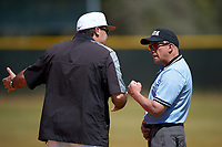 Illinois State Redbirds head coach Bo Durkac argues a call with umpire Kyle George during a game against the Michigan State Spartans on March 8, 2016 at North Charlotte Regional Park in Port Charlotte, Florida.  Michigan State defeated Illinois State 15-0.  (Mike Janes/Four Seam Images)