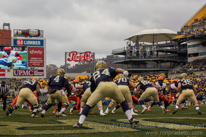 Pitt running back James Conner (24) lines up behind the Pitt offensive line. The Pitt Panthers defeated the Syracuse Orange 76-61 at Heinz Field in Pittsburgh, Pennsylvania on November 26, 2016.