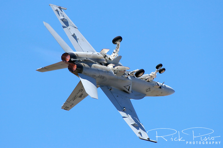 "Lt. Sarah ""Diamond"" Rhoads executes a barrel roll on takeoff while flying a F/A-18F Super Hornet during the 2007 Wings Over the Wine Country Airshow in Santa Rosa California. The Boeing built 2 seat F/A-18F Super Hornet is 25% larger that its predecessor the F/A-18D Hornet and entered service with the US Navy in 1999 as a replacement for the F-14D Tomcat. Photographed 08/07"