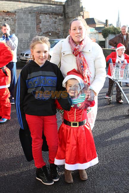 Jennifer, Amie and Lynette Dolan at the 2012 Christmas Bonanza Santa Run...Photo NEWSFILE/Jenny Matthews..(Photo credit should read Jenny Matthews/NEWSFILE)