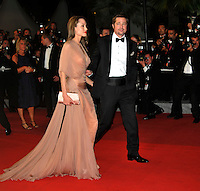 ANGELINA JOLIE &amp; BRAD PITT <br /> Leaving the premiere of &quot;Inglorious Basterds&quot;  at the Grand Theatre Lumiere  during the 62nd Cannes International Film Festival, Cannes, France, <br /> May 20th 2009.<br /> full length departures black suit tux tuxedo Tom Ford long beige peach silk dress maxi draped v-neck clutch bag satin shoes open toe cream couple leaving walking bow tie white shirt leg thigh slit split side profile sheer <br /> CAP/PL<br /> &copy;Phil Loftus/Capital Pictures /MediaPunch ***NORTH AND SOUTH AMERICAS ONLY***