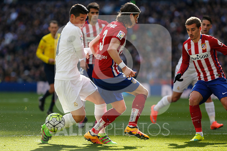 Real Madrid´s James Rodriguez and Atletico de Madrid´s Filipe Luis during 2015/16 La Liga match between Real Madrid and Atletico de Madrid at Santiago Bernabeu stadium in Madrid, Spain. February 27, 2016. (ALTERPHOTOS/Victor Blanco)