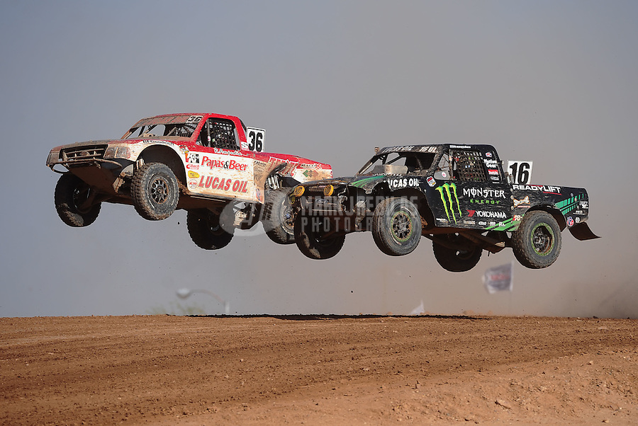 Apr 17, 2011; Surprise, AZ USA; LOORRS driver Cameron Steele (16) races alongside Rodrigo Ampudia (36) during round 4 at Speedworld Off Road Park. Mandatory Credit: Mark J. Rebilas-