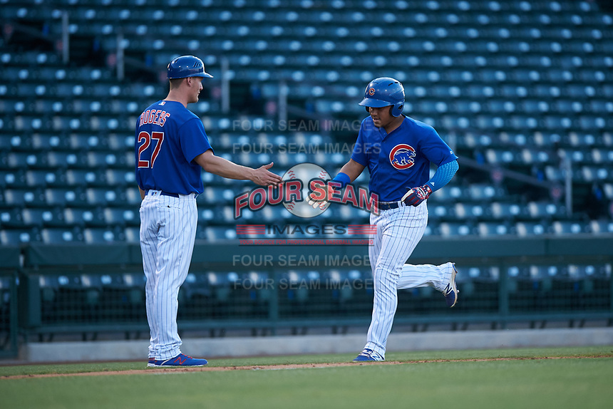 AZL Cubs 1 Ervis Marchan (21) is congratulated by hitting coach Jacob Rogers (27) after hitting a home run during an Arizona League game against the AZL Angels on June 24, 2019 at Sloan Park in Mesa, Arizona. AZL Cubs 1 defeated the AZL Angels 12-0. (Zachary Lucy / Four Seam Images)