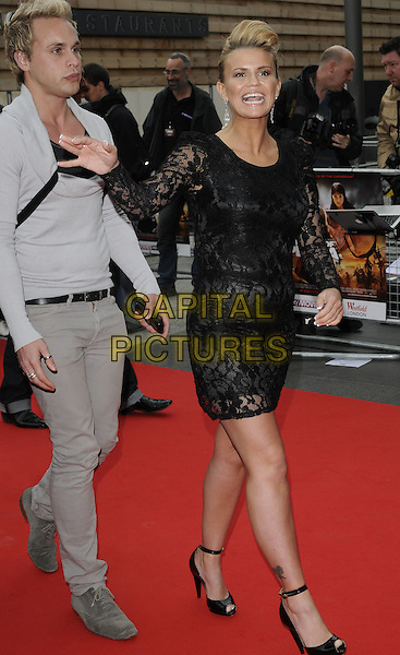"KERRY KATONA .At the World Film Premiere of ""Prince of Persia: The Sands Of Time"", Vue cinema at Westfield shopping centre, London, England, 9th May 2010..arrivals full length black lace sleeves sleeve see thru through walking funny ankle strap peep toe shoes tanned  hand waving mouth open .CAP/CAN.©Can Nguyen/Capital Pictures."