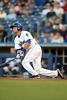 Tulsa Drillers second baseman Taylor Featherston (12) at bat during a game against the Midland RockHounds on May 30, 2014 at ONEOK Field in Tulsa, Oklahoma.  Tulsa defeated Midland 7-1.  (Mike Janes/Four Seam Images)