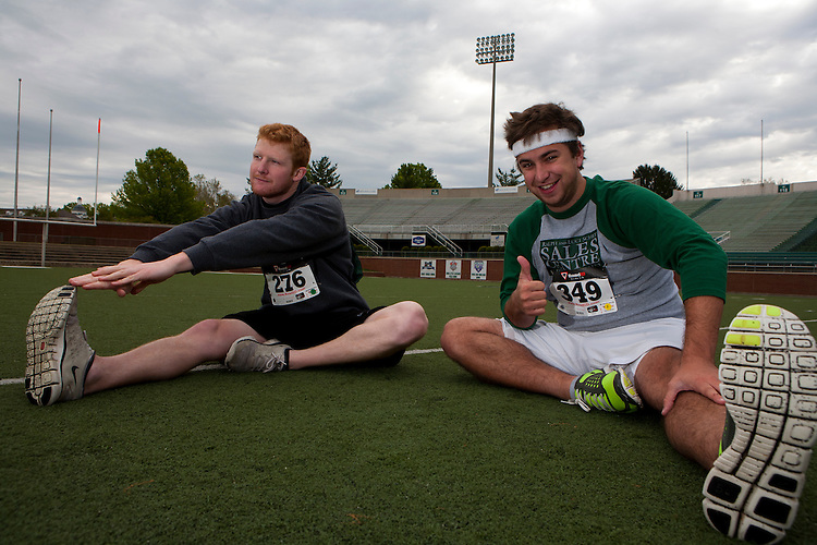 Sam Wright and Clark Saul stretch before the Race for a Reason.