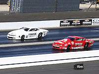 Feb 14, 2016; Pomona, CA, USA; NHRA pro stock driver Joey Grose (left) races alongside Drew Skillman during the Winternationals at Auto Club Raceway at Pomona. Mandatory Credit: Mark J. Rebilas-USA TODAY Sports