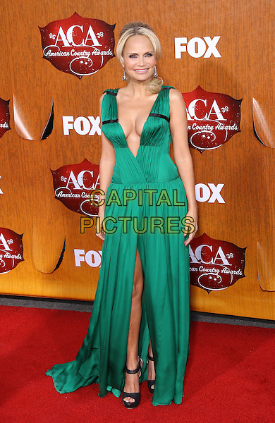 Kristin Chenoweth.2011 American Country Awards at the MGM Grand Casino Resort, Las Vegas, Nevada, USA..December 5th, 2011.full length green dress low cut plunging neckline cleavage slit split black shoes open toe ankle strap .CAP/ADM/MJT.© MJT/AdMedia/Capital Pictures.