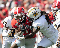 ATHENS, GA - SEPTEMBER 7: Kendrick Catis #6 tackles D'Andre Swift #7 during a game between Murray State Racers and University of Georgia Bulldogs at Sanford Stadium on September 7, 2019 in Athens, Georgia.