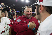 Arkansas Democrat-Gazette/BENJAMIN KRAIN --12/29/14--<br /> Bret Bielema celebrates the Razorbacks victory after defeating Texas in theTexas Bowl Monday in Houston.