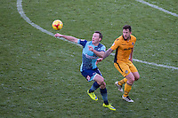Garry Thompson of Wycombe Wanderers & Darren Jones of Newport County during the Sky Bet League 2 match between Wycombe Wanderers and Newport County at Adams Park, High Wycombe, England on 2 January 2017. Photo by Andy Rowland.