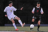 Jake Bresnihan #16 of Massapequa, left, and Dylan Gefter #13 of Syosset battle for possession during the Nassau County Class AA varsity boys soccer playoffs at Adelphi University on Sunday, Oct. 30, 2016. Thunder, lightning and heavy rain necessitated a delay nine minutes into the second half a scoreless match.