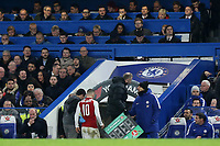 Arsenal's Jack Wilshere is substituted after suffering an injury and heads to the dressing room. Arsenal Manager, Arsene Wenger, looks on from the Press Box during Chelsea vs Arsenal, Caraboa Cup Football at Stamford Bridge on 10th January 2018