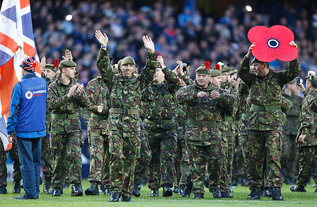 Members of the armed forces on the pitch at half-time