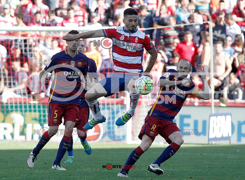 Granada's Fran Rico (c) and FC Barcelona's Sergio Busquets (l) and Andres Iniesta during La Liga match. May 14,2016. (ALTERPHOTOS/Acero) /NortePhoto.com