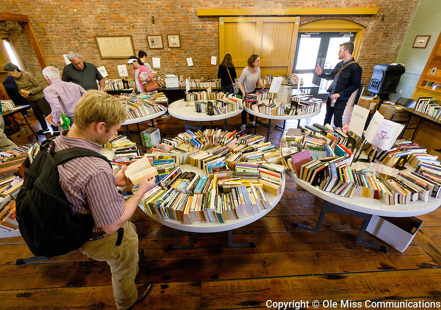 Book aficionados browse through the thousands of books available at the most recent Jan Hawks Memorial Book Sale held at the Depot. Photo by Robert Jordan/Ole Miss Communications