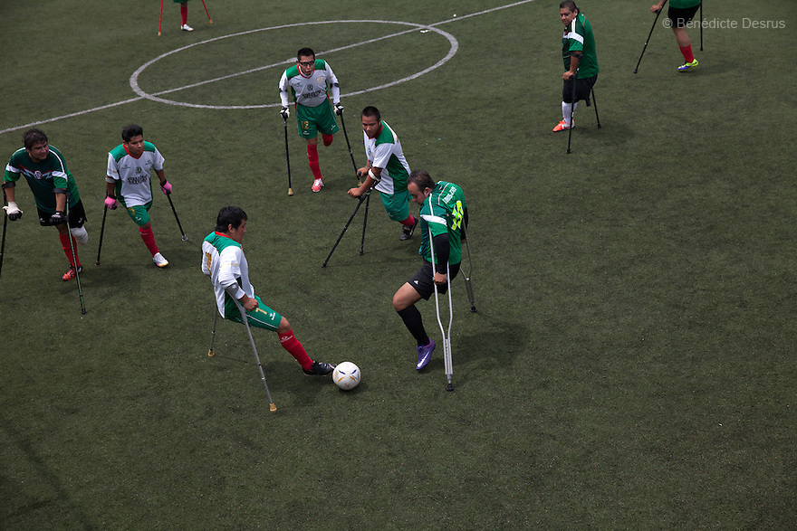 """Players from Guerreros Aztecas during a soccer game with the team in Mexico City, Mexico on September 13, 2014. Guerreros Aztecas (""""Aztec Warriors"""") is Mexico City's first amputee football team. Founded in July 2013 by five volunteers, they now have 23 players, seven of them have made the national team's shortlist to represent Mexico at this year's Amputee Soccer World Cup in Sinaloathis December.The team trains twice a week for weekend games with other teams. No prostheses are used, so field players missing a lower extremity can only play using crutches. Those missing an upper extremity play as goalkeepers. The teams play six per side with unlimited substitutions. Each half lasts 25 minutes. The causes of the amputations range from accidents to medical interventions – none of which have stopped the Guerreros Aztecas from continuing to play. The players' age, backgrounds and professions cover the full sweep of Mexican society, and they are united by the will to keep their heads held high in a country where discrimination against the disabled remains widespread.(Photo byBénédicte Desrus)"""