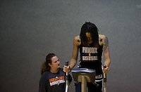 Jun. 10, 2013; Phoenix, AZ, USA: Phoenix Mercury center Brittney Griner (right) works with a team trainer during a team practice at the US Airways Center. Mandatory Credit: Mark J. Rebilas-