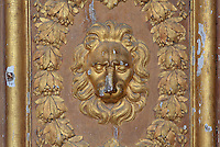 Carved wooden lion's head and wreath border on the Porte Doree, built 16th century under Francois I and the main entrance until the 17th century, at the end of the líAllee de Maintenon, an avenue of lime trees, Chateau de Fontainebleau, France. The gate leads to the King's private chapel. The Palace of Fontainebleau is one of the largest French royal palaces and was begun in the early 16th century for Francois I. It was listed as a UNESCO World Heritage Site in 1981. Picture by Manuel Cohen