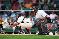 Birmingham Barons catcher Adrian Nieto (6) and umpire J.J. January during the 20th Annual Rickwood Classic Game against the Jacksonville Suns on May 27, 2015 at Rickwood Field in Birmingham, Alabama.  Jacksonville defeated Birmingham by the score of 8-2 at the countries oldest ballpark, Rickwood opened in 1910 and has been most notably the home of the Birmingham Barons of the Southern League and Birmingham Black Barons of the Negro League.  (Mike Janes/Four Seam Images)