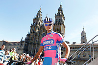 Przemyslaw Niemiec passes by the front of the Obradoiro of the Cathedral of Santiago de Compostela before the stage of La Vuelta 2012 between Santiago de Compostela and Ferrol.August 31,2012. (ALTERPHOTOS/Acero)