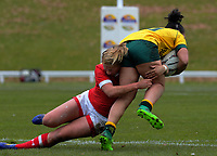 Emily Belchos tackles Fenella Hake during the 2017 International Women's Rugby Series rugby match between Canada and Australia Wallaroos at Smallbone Park in Rotorua, New Zealand on Saturday, 17 June 2017. Photo: Dave Lintott / lintottphoto.co.nz