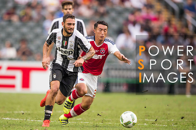 Juventus' player Grigoris Kastanos contests the ball during the South China vs Juventus match of the AET International Challenge Cup on 30 July 2016 at Hong Kong Stadium, in Hong Kong, China.  Photo by Marcio Machado / Power Sport Images