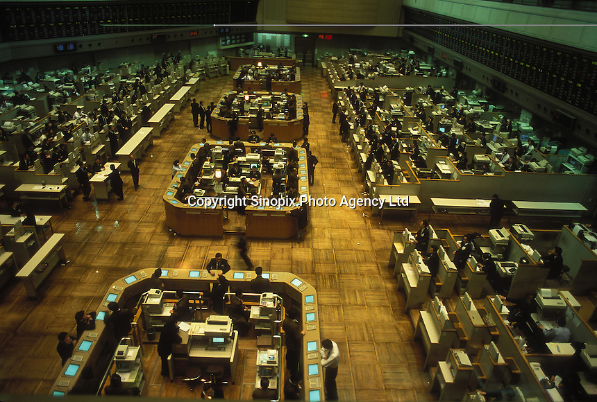 "A great quantity of staffs work in the ""old"" Tokyo Stock exchange (TSE) before renovation, Tokyo, Japan. Tokyo Stock Exchange is the second largest stock exchange in the world after the New York Sotck Exchange, it is a central Institution of the Japanese securities secondary market and has contributed to the growth of the Japanese economy as the stock exchange representing Japan..21 Jul 1998"