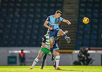Luke O'Nien of Wycombe Wanderers wins the ball in the air during the Sky Bet League 2 match between Wycombe Wanderers and Yeovil Town at Adams Park, High Wycombe, England on 14 January 2017. Photo by Andy Rowland / PRiME Media Images.