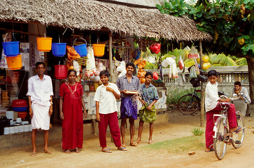 In Valicau's village town, also called Valicaru Village general store owner and his family in front of their shop, Kerala state, India
