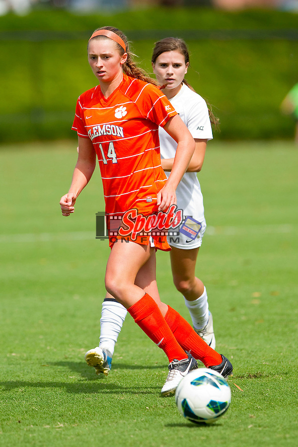Allie Kington #14 of the Clemson Tigers passes the ball during first half action against the Wake Forest Demon Deacons at Spry Soccer Stadium on September 30, 2012 in Winston-Salem, North Carolina.  The Demon Deacons defeated the Tigers 4-0.  (Brian Westerholt/Sports On Film)