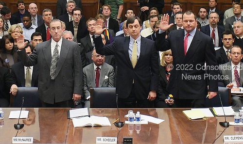 At the table, from left, Brian McNamee, former personal trainer to Roger Clemens, Charlie Scheeler, member of the investigating staff for former Sen. George Mitchell's report, and former New York Yankees pitcher Roger Clemens swear under oath before testifying before the House Oversight and Government Reform Committee on Capitol Hill in Washington, D.C., Wednesday, February 13, 2008, about the illegal use of steroids and other performance enhancing drugs in baseball. (Chuck Kennedy/MCT)