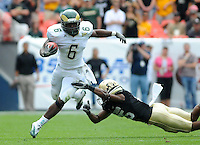 SEPTEMBER 17, 2011:  Colorado Buffaloes defensive back Ayodeji Olatoye (25) tackles Colorado State Rams running back Chris Nwoke (6)    during an inter-conference game between the Colorado State Rams and the University of Colorado Buffaloes at Sports Authority Field at Mile High Field in Denver, Colorado. The Buffaloes led 14-7 at halftime*****For editorial use only*****