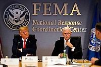 United States President Donald J. Trump and US Vice President Mike Pence attend a teleconference with governors at the Federal Emergency Management Agency headquarters, Thursday, March 19, 2020, in Washington. <br /> Credit: Evan Vucci / Pool via CNP/AdMedia