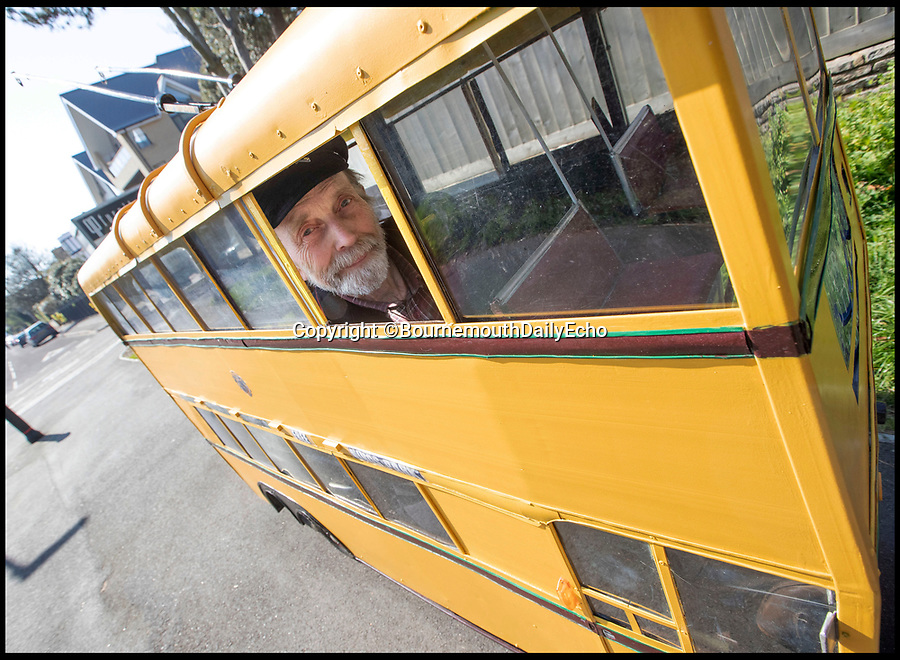 BNPS.co.uk (01202 558833)<br /> Pic: CorinMesser/BournemouthEcho<br /> <br /> Jolly Trolley...<br /> <br /> A pensioner has paid homage to the humble trolleybus by converting a mobility scooter into one of the vintage vehicles.<br /> <br /> Keith Burbidge, a 77-year-old retired bus driver, decided to mark the 50th anniversary of the last electric bus to travel in his hometown by creating a miniature version of one.<br /> <br /> Keith used an electric buggy as the base for his wacky invention and created the superstructure from discarded aluminium.<br /> <br /> He also installed two seats, one behind the other, and 30 perspex windows. He and wife Carol now drive the 5mph bus around Bournemouth, Dorset.