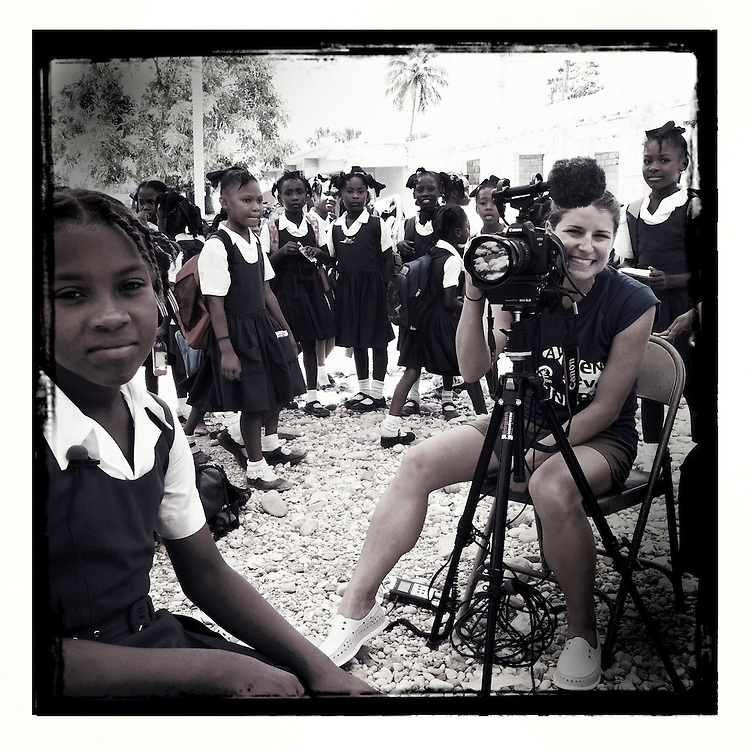 10x10 Field Producer Gina Nemirofsky with girls from the National Girls School, sponsored by 10x10 partner Plan, in Jacmel, Haiti.