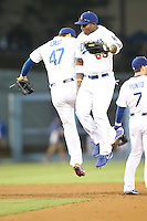06/06/13 Los Angeles, CA: Los Angeles Dodgers right fielder Yasiel Puig #66 and Los  third baseman Luis Cruz #47 congratulate each other after the Dodgers defeated the Braves 5-0.