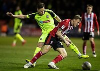 Bolton Wanderers' Dennis Politic competing with Lincoln City's Harry Anderson (right) <br /> <br /> Photographer Andrew Kearns/CameraSport<br /> <br /> The EFL Sky Bet League One - Lincoln City v Bolton Wanderers - Tuesday 14th January 2020  - LNER Stadium - Lincoln<br /> <br /> World Copyright © 2020 CameraSport. All rights reserved. 43 Linden Ave. Countesthorpe. Leicester. England. LE8 5PG - Tel: +44 (0) 116 277 4147 - admin@camerasport.com - www.camerasport.com