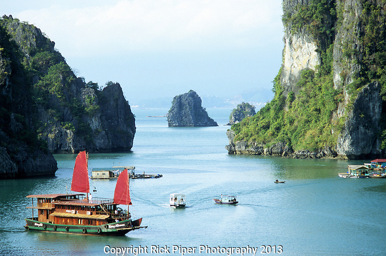 Halong Bay Sails 03 - Tourist junk cruise boat with red sails, Halong Bay, Viet Nam