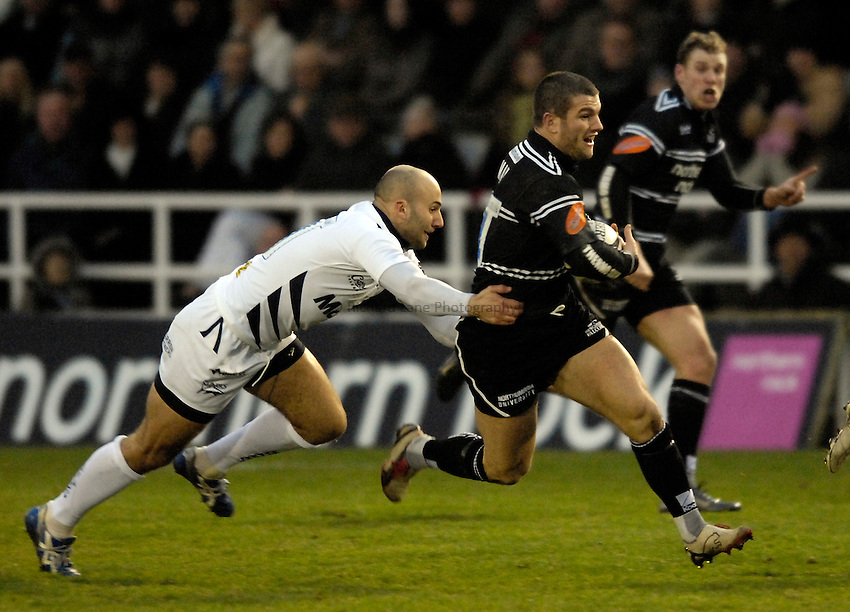 Photo: Jed Wee..Newcastle Falcons v Sale Sharks. Guinness Premiership. 26/12/2006...Newcastle's Tom May (R) breaks past Sale's Daniel Larrechea.