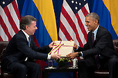 (L to R) President of Colombia Juan Manuel Santos gives United States President Barack Obama a copy of the Colombian peace agreement during bilateral meeting at the Lotte New York Palace Hotel, September 21, 2016 in New York City. In Tuesday's speech to the United Nations General Assembly, Obama stated that 'helping Colombia end Latin America's longest war' was among his major accomplishments as president. Last month, the Colombian government reached a peace agreement with the Revolutionary Armed Forces of Colombia (FARC). <br /> Credit: Drew Angerer / Pool via CNP