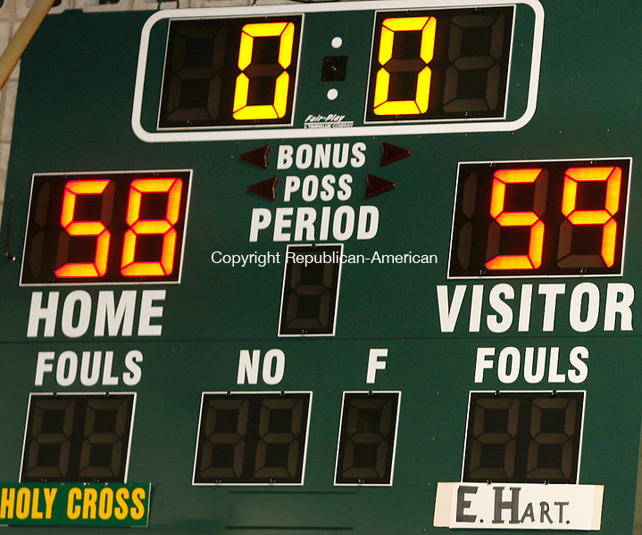 Holy Cross' Timothy Brady defends agains the  The Crusaders were defeated by the Hornets 58-59  Michael Kabelka Republican / American.