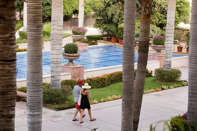 Couple walking through the grounds at Pueblo Bonito Rose' Resort, Cabo San Lucas, Baja California, Mexico