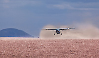 Small private aircraft taking off from a dusty rural airstrip near Chyulu Hills of Eastern Kenya, Africa (photo by Wildlife Photographer Matt Considine)