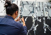 New York, NY 12 September 2015 -  Fan taking a photo of Futura (aka Lenny McGurr, Futura 2000)  work-in-progress at the Bowery Mural