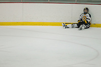 Daniel Maier #43 of Penn-Trafford sits along the boards following their loss to Bethel Park in the PIHL semifinal game at the Robert Morris University Island Sports Center on Neville Island on March 21, 2012 in Pittsburgh, PA...(Jared Wickerham/For The Tribune-Review).JWPT-Bethel322.jpg.